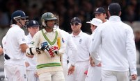 Cold shoulder: England players stare at Pakistan's Mohammad Aamer after he bowled no balls during the Test at Lord's
