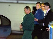 Peter Dupas is taken to a police car for his return from St Kilda road police station to Barwon Prison.