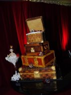 Joel Morehu-Barlow's designer birthday cakes - a caricature of himself in a champagne glass and edible Louis Vuitton trunks.