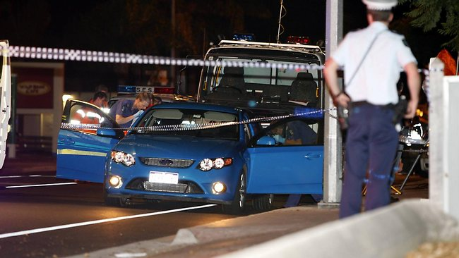 Police search the vehicle in which Giovanni Focarelli's body was found in. Picture