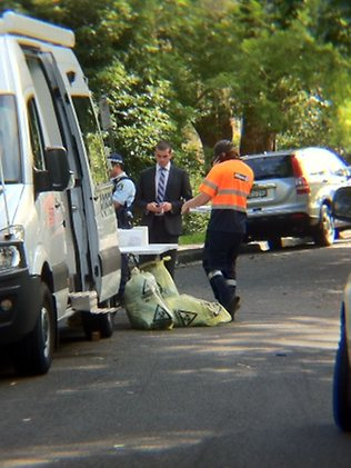 Police discovered a body - believed to be chopped up and stored in the freezer - in a unit on View St, Chatswood