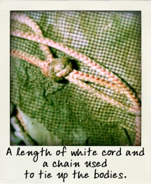 A length of white cord and a chain used to tie up the bodies.-pola