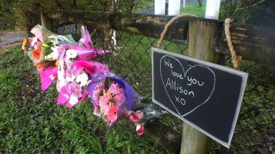 Flowers and dedications left outside the home