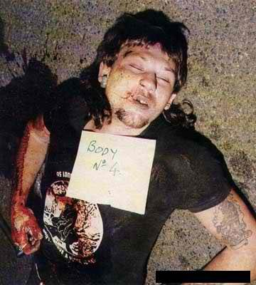 """Comanchero """"Sparrow"""" was shot with one round of a shotgun and was shot at such close range that the cartridge wadding can be clearly seen embedded in his right ear. He died instantly with a baseball bat under his body"""