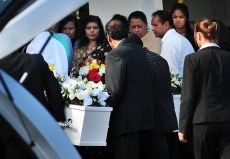 Family and friends began farewelling Nilesh and Priti Sharma and their children Divesh, 5, and Divya, 3, in a joint funeral at the Springvale Botanical Cemetery at 1.15pm.