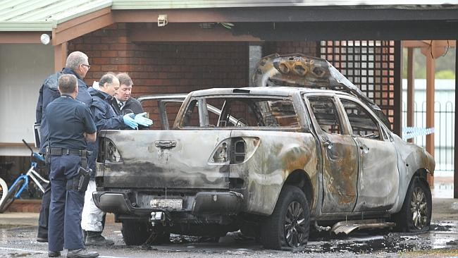 Police investigate after the attack on Bill Vlahos's car.