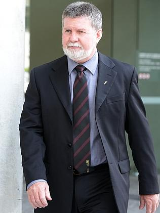 Detective Sgt. Graeme Farlow leaving the court.