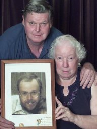 Ron and Patricia Parsons with a picture of their murdered son Paul.