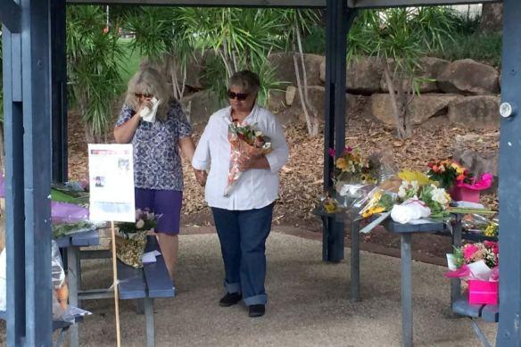 Diane Milward (left), mother of Benjamin James Milward, visits a memorial to murdered Sophie Collombet in south Brisbane on April 8, 2014.