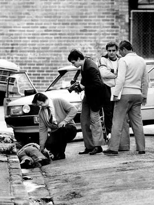 Det-Sgt Roger Rogerson (far right) with other detectives after Warren Lanfranchi was shot dead