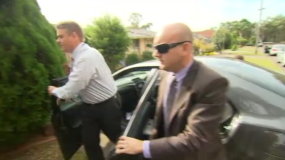 Detectives have arrived at Roger Rogerson's home