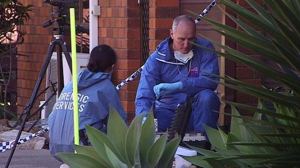 Forensic police conduct an investigation at the family home of a toddler who was raped and killed, on Easter Monday.