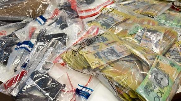 Gang Crime Squad officers have charged four people over raids which netted multiple guns, ammunition, drugs and $380,000 in cash