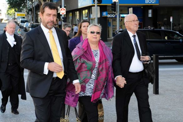 Parents of Gerard Baden-Clay, Nigel and Elaine, along with their lawyer Peter Shields (left) arrive at court.