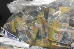 $1 million cash was seized from a safe deposit box by the AFP in yesterday's raid.