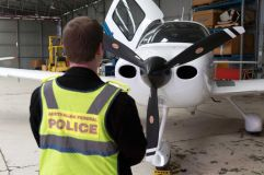 A light aircraft seized by police as part of their investigation. AFP